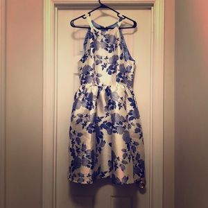 Halter fit & flare dress with blue floral pattern.